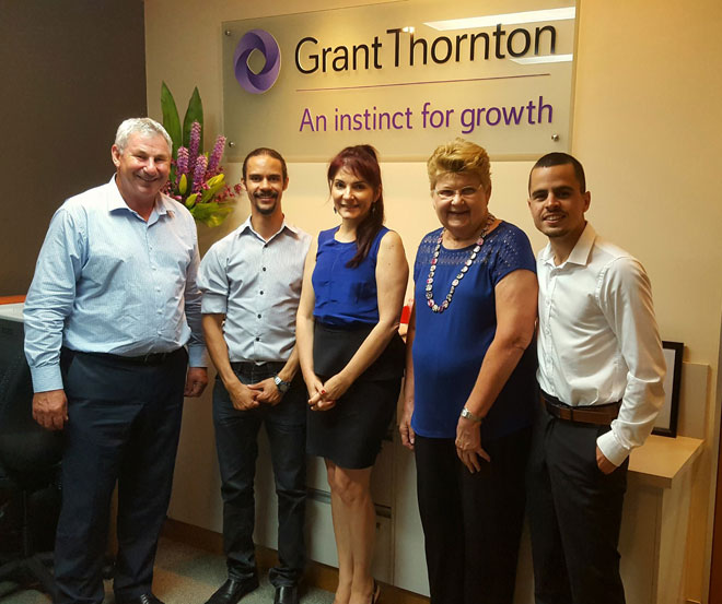 Jesse with staff at Grant Thornton's office