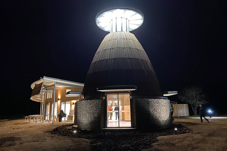Night view of a building in the form of an inverted cup