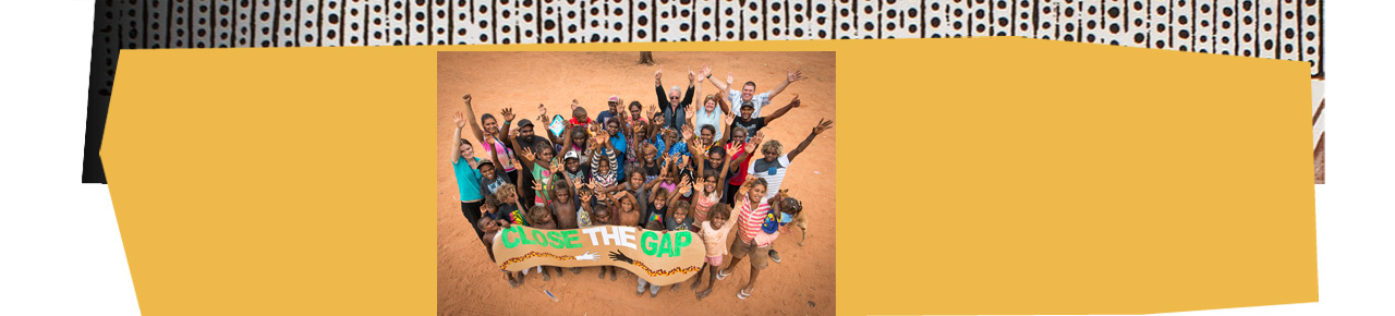 Photo of community members celebrating close the gap