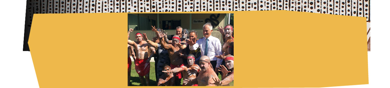 Prime Minister Malcolm Turnbull standing with a group of Indigenous men