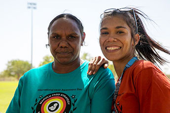Young Aboriginal women marching to raise awareness of foetal alcohol syndrome disorders