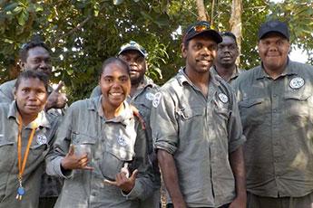 Eight Dhimurru rangers posing for the camera in Nhulunbuy, northeast Arnhem Land