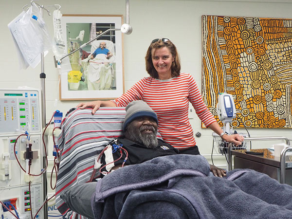 Aboriginal man on dialysis with a woman standing behind