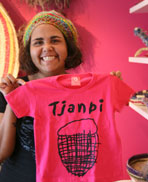 Sally Scales from Tjanpi. As well as artworks, Tjanpi sells a range of merchandise.