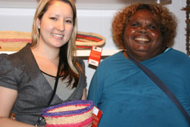 Artist Maureen Douglas with ORIC's Sayuri Piper holding one of the artist's baskets.