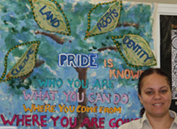 Thelma Phillips with 'pride, land, roots' banner