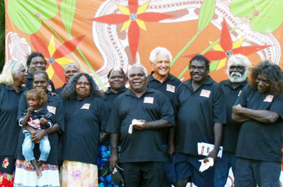 Members of the Red Lily Health Board Aboriginal Corporation at the official launch of its services: Daisy Yarmirr, Mary Djurundudu, Rhoda Nglmaku, June Nadjamerrek, Rosemary Nabulwad, Ross Guymala, Rueben Cooper, Michael Bangalang, Sampson Henry, Christopher Galaminda with baby Tyson—future chairperson or CEO of Red Lily.