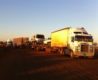 Loaded trucks going out to the Lands.