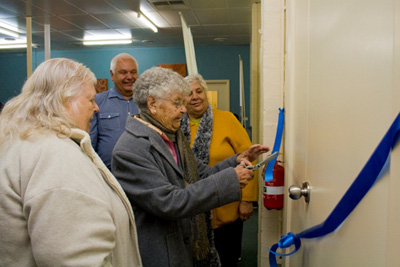 Aunty Irene Harrison, Aunty Jessie Clarke and Aunty Faye Marks officially open the offices watched by BGLC director, Frank Clarke