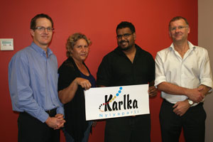 Karlka under new management. The Registrar, Anthony Beven, with directors Christina Stone and Bradley Hall holding the corporation's new logo design, and special administrator Jack James. The corporation has also moved into new premises in Port Hedland's business district