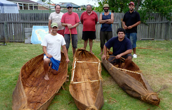 Workshop participants with their tied-bark canoes (back from left to right): Paul Carriage of Budamurra Aboriginal Corporation, David Payne from the Australian National Maritime Museum, Tom Butler, James Nye and Cameron Andy from Mogo Local Aboriginal Land Council (front) Jonathan Hill and Gordon Campbell from Vincentia High School. Photo: David Payne/ANMM