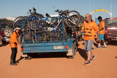 Photo: Loading the bikes: Each year UTHSAC runs COBRA (Coober—Oodnadatta Bike Ride Adventure). Over three days, 10 males and 10 boys with a support crew ride mountain bikes some 200 kilometres. Along the way they camp, enjoy the outdoors, learn about culture and discuss important matters, such as how to stay healthy and happy, and how to find direction in life. Photo courtesy UTHSAC