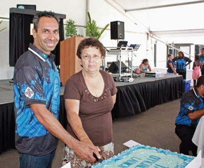 chairperson and member cutting the cake