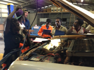 Participants in the young men's automotive training program