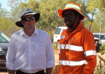 Dugalunji training program graduate and prospective engineering cadet, Tristan Elu, from Lockhart River (right), chats to UQ's Professor Darren Martin about nanotechnology and its use in spinifex research.
