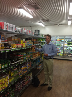 Anthony Beven standing near a shelf in the store