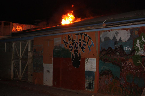 Kaltjiti store on fire. Flames coming out from the roof of the store.