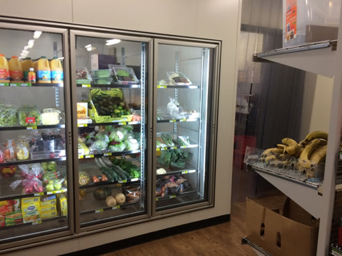 fridge displaying fresh produce and juice in the kaljitti store