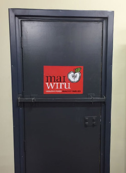 Mai Wiru logo on the door in Kaljitti store