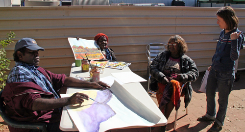 From left to right: Reinhold Inkamala, Ivy Pareroultja, Lenie Namatjira with (standing) art centre manager Iris Bendor