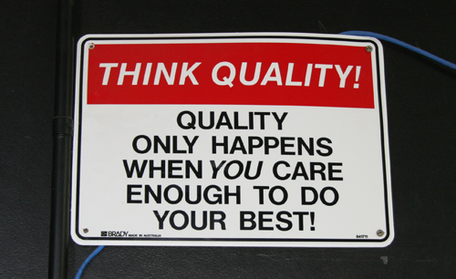 "Sign saying ""think quality"""