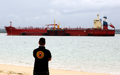 CEO of Rirratjingu Aboriginal Corporation, Stuart Maclean, overseeing a shipment of fuel