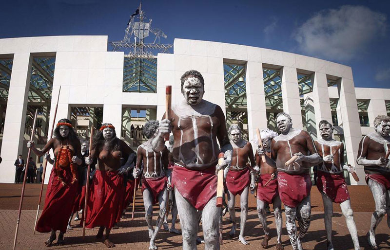Yolngu people perform a Djang'kawu ceremony at Parliament House in Canberra, as part of a campaign to stop domestic violence