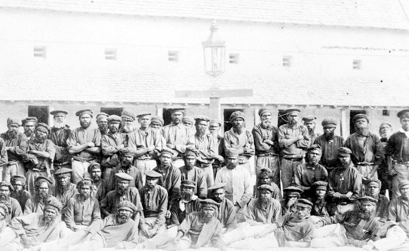 Large group of Aboriginal prisoners arranged for a photograph in The Quod, 1892