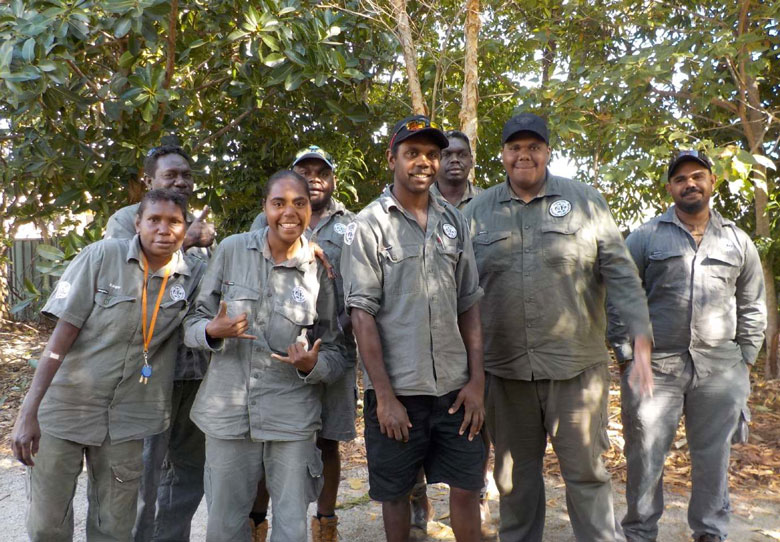 Eight Dhimurru rangers posing for the camera in Nhulunbuy, northeast Arnhem Land