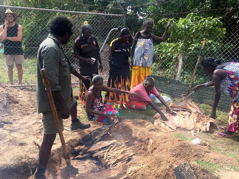 Dhimurru rangers extracting cooked yams during NAIDOC Week in Nhulunuby 2019