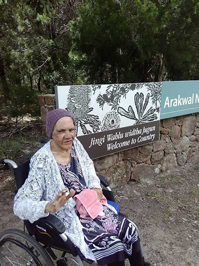 Aunty Dulcie, Arakwal traditional custodian elder at the newly appointed Arakwal National Park sign near Tallow Creek, New South Wales
