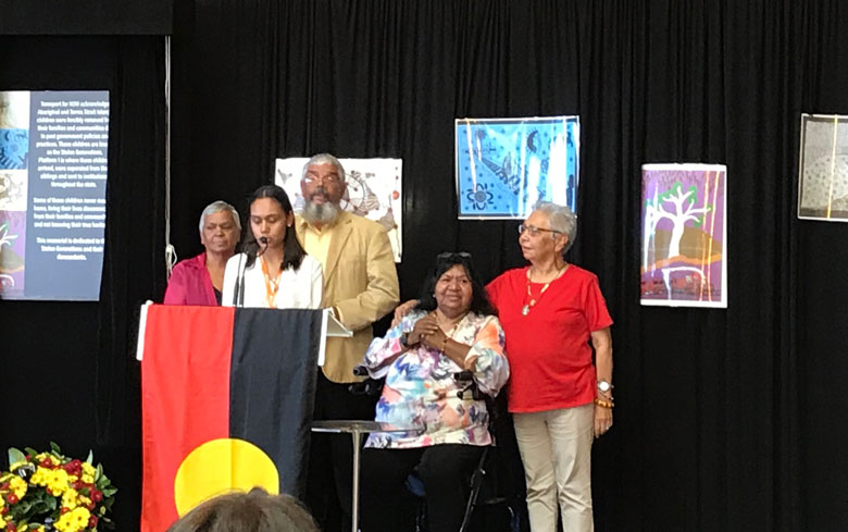 Five people on stage to open the memorial to the Stolen Generations at Sydney Central railway station