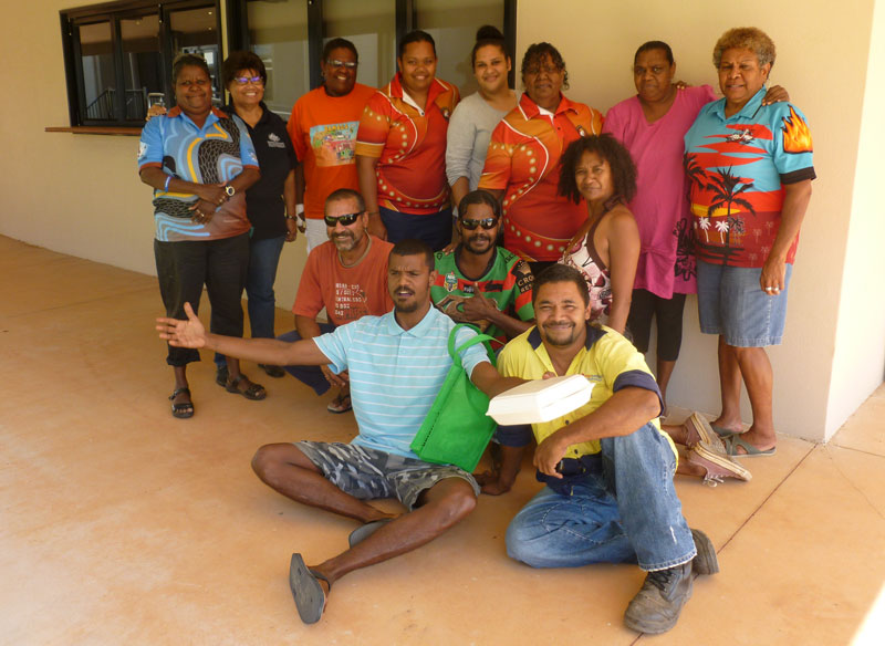 Group of smiling Aboriginal people in front of a building