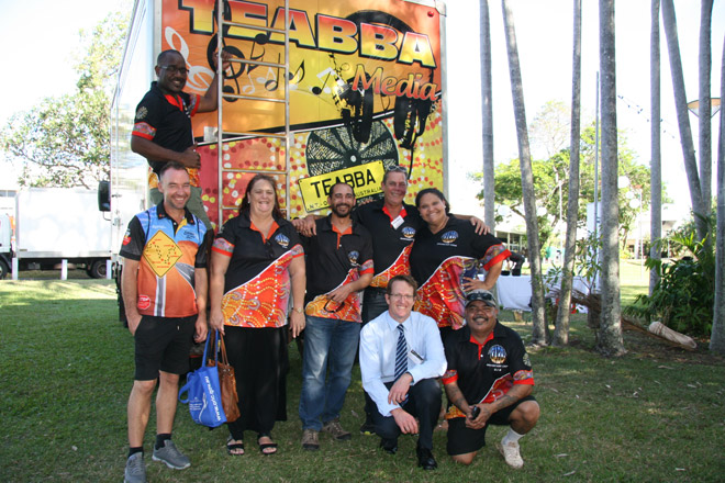 TEABBA staff and the Registrar of Indigenous Corporations in front of TEABBA's outside broadcasting bus