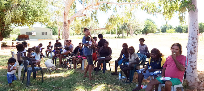 Group of Aboriginal people seated in the shade