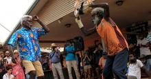 Two men dancing to celebrate community-controlled health at Mala'la Health Service Aboriginal Corporation in Maningrida