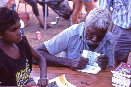 'Kakadu man' Bill Neidjie signing a copy of his book Story About Feeling, 1989