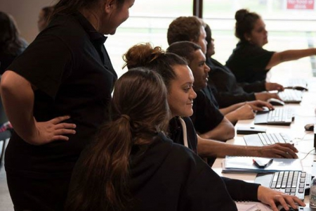 A row of Aboriginal students studying health in a computer lab